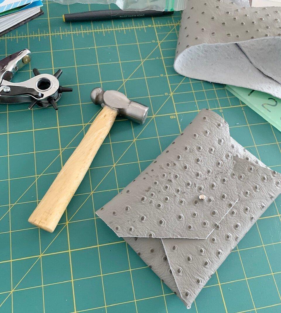 A handmade leather wallet in progress.